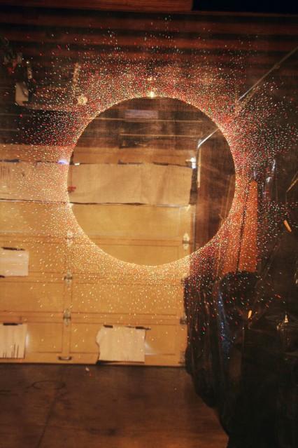 """Al Wong, """"Round"""" ©2015, 8'H x 5'W, Acrylic on fiberglass netting."""